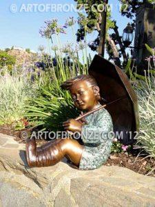 Summer Breeze bronze garden sculpture of cute young girl in the sun with umbrella