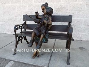 Mom Knows Best Bronze sculpture of little girl sitting on moms lap being read a book