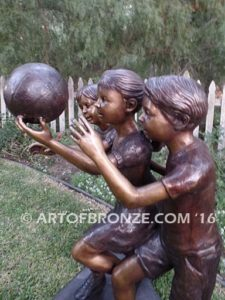 Playing Ball bronze sculpture of girl and two boys juggling ball