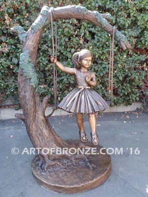 The Swing sculpture of pretty princess girl wearing dress on swing
