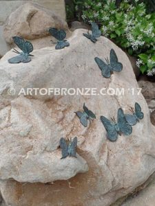 Butterfly Migration statue of rock with butterflies on it