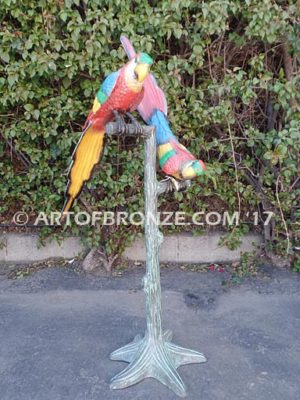 Double Talk statue of two macaws on a branch together