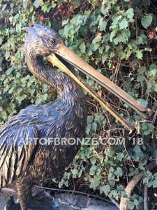 Along the Shore (I) bronze sculpture of life-size wild heron.