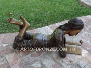 Best in Her Class SV bench bronze statue of girl lying down reading book