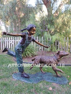 Friends for Life bronze sculpture of girl playing and running with her pet dog