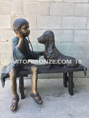 Future Vet bronze sculpture of veterinarian boy with stethoscope and dog on bench