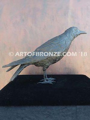 Raven bronze sculpture of life-size raven looking straight ahead