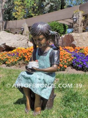 Birthday Wishes bronze statue of girl with birthday cake