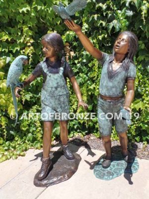 Bird Lovers bronze statue of two girls playing with their pet birds