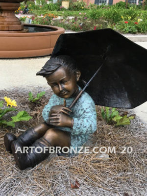 Summer Breeze bronze garden sculpture of cute young girl in the sun with umbrella