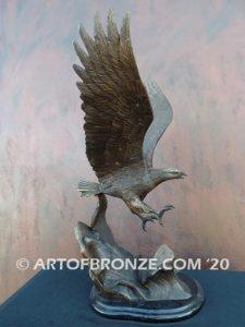 Bronze sculpture of flying eagle on custom marble base