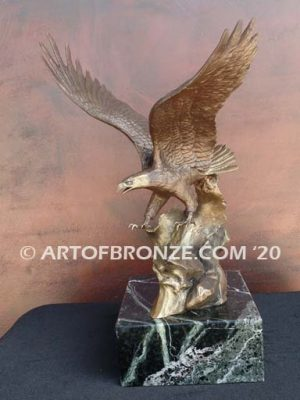 bronze sculpture of flying eagle on custom marble base
