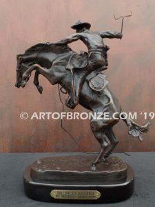 Bronco Buster bronze sculpture after Frederic Remington of cowboy ranger on horse