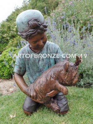Play Pal bronze sculpture of young boy holding his dog