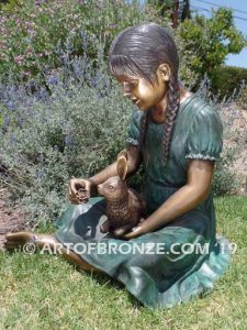 Feeding My Rabbit Sideview Bronze Girl Statue