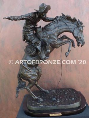 Bronco Buster bronze sculpture after Frederic Remington of cowboy ranger on horse in white house