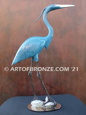 Heron in Everglades sculpture graceful heron looking in the everglades by British artist Brian Arthur