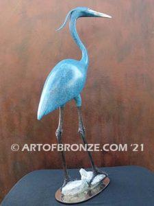 Heron in Everglades sculpture heron standing on rocks by British artist Brian Arthur